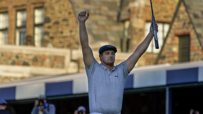 Bryson DeChambeau reacts after sinking a putt for par on the 18th hole to win the US Open Golf Championship, Sunday, Sept. 20, 2020, in Mamaroneck, N.Y.