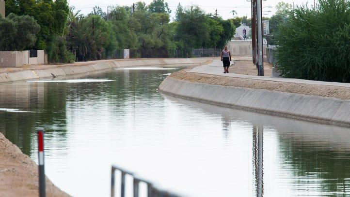 John Henry, 27, walks along the Grand Canal near Central