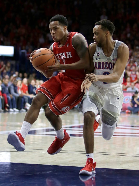 Utah guard Justin Bibbins (1) drives against Arizona guard Parker Jackson-Cartwright in the first half of an NCAA college basketball game, Saturday, Jan. 27, 2018, in Tucson, Ariz. (AP Photo/Rick Scuteri)