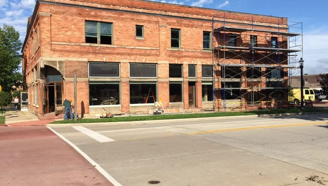 Julie's Cafe and Brickhouse Craft Burgers & Brews will open next month in the former Sports Corner building at 500 Grant St. The restaurants are owned by Steve and Troy Metzler.