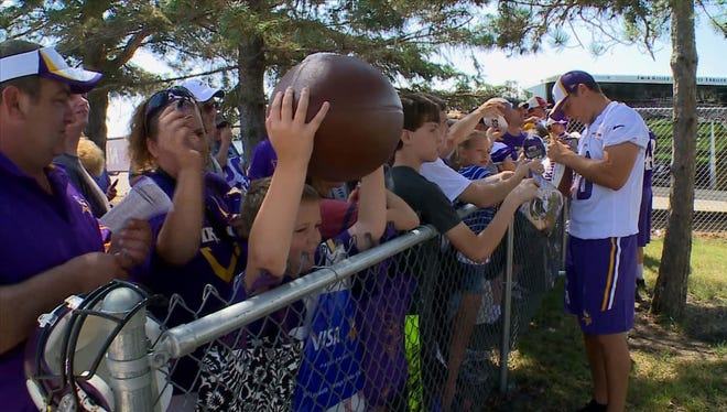 10-year-old Bennett came prepared to gets lots of autographs at Vikings Training Camp in Mankato.
