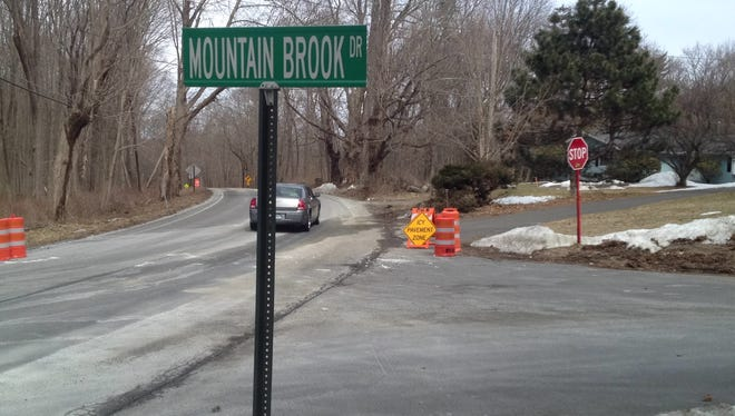 The scene along Milltown Road in Southeast of a one-vehicle crash that injured four men from Brewster in the early morning of March 17, 2014.