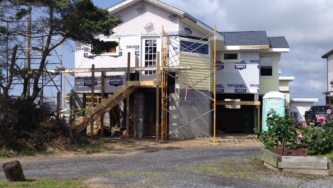 The Bruhl family home, under reconstruction in Dewey Beach, is being elevated by 8 feet to avoid future flood risks.
