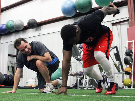 Our Rutgers football writer Ryan Dunleavy learns the proper 40-yard dash start position footwork from former Rutgers star Lorenzo Waters.