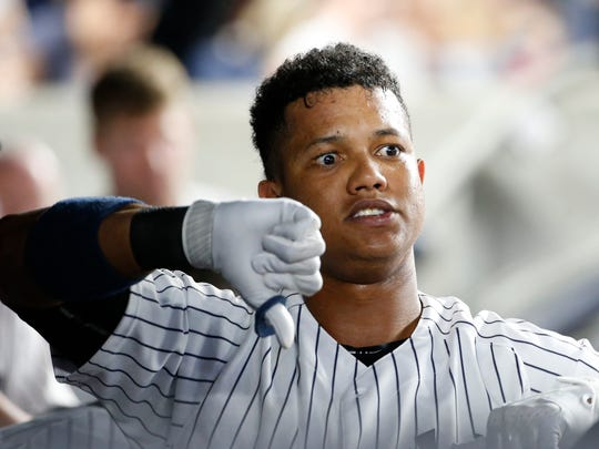 New York Yankees' Starlin Castro goes through a routine