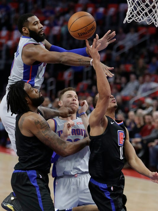 Detroit Pistons center Andre Drummond, top left, blocks a shot by Los Angeles Clippers guard Avery Bradley (11) during the first half of an NBA basketball game, Friday, Feb. 9, 2018, in Detroit. (AP Photo/Carlos Osorio)