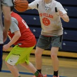 Coach Josh Sagester, center, leads basketball practice at Tri-Village High School, Tuesday, March 24, 2015, in New Madison, Ohio.