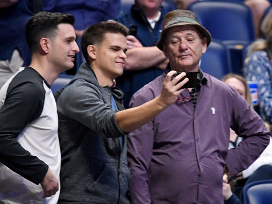 Fans take a selfie with actor Bill Murray, whose son