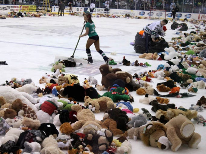 A variety of stuffed animals begin to collect on the ice at Germain Arena during Teddy Bear Toss night following the Everblades first goal against Colorado on Saturday night.
