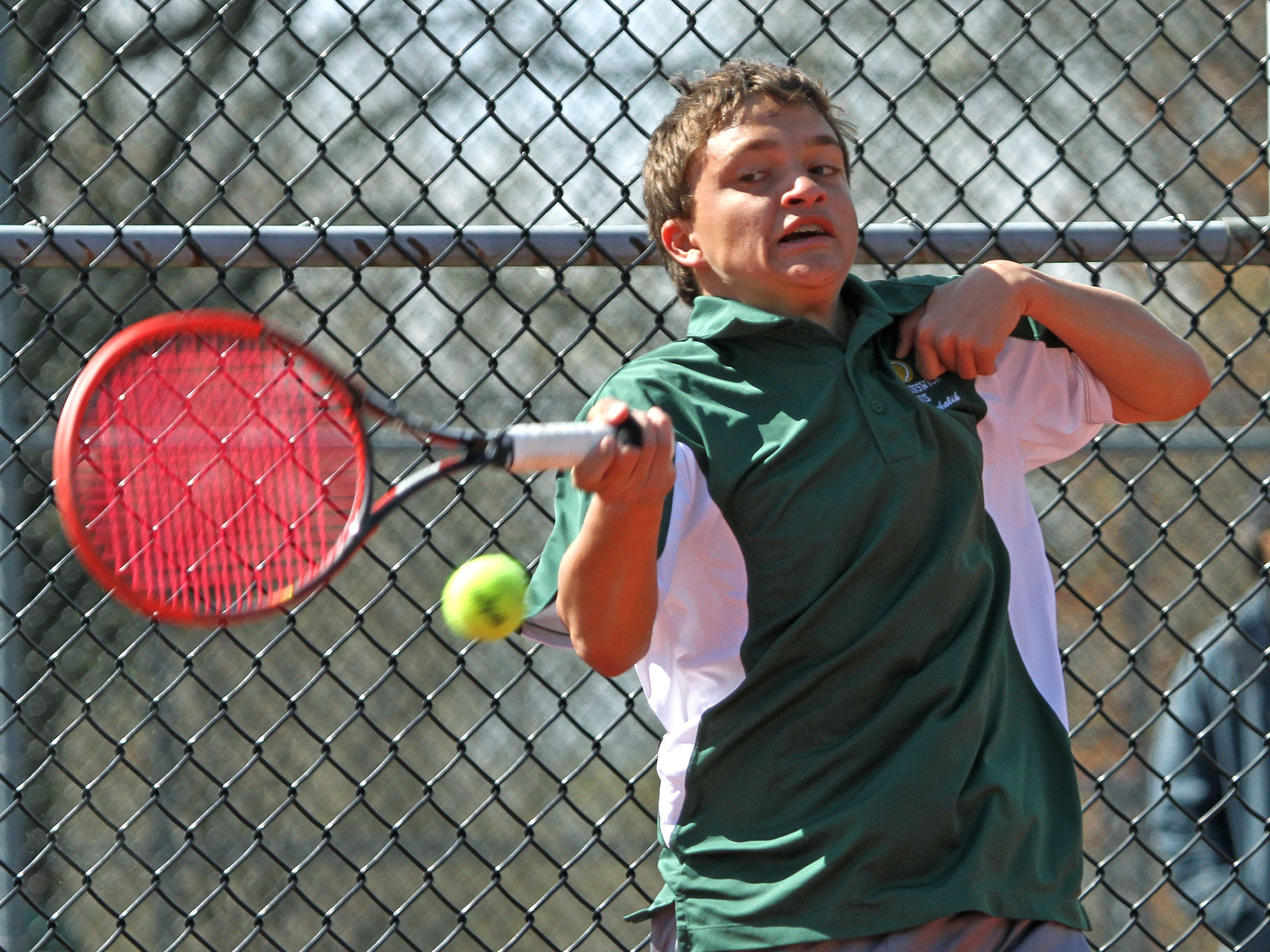 East Brunswick's Josh Marchalik competes in the First Singles match in the GMC tennis tournament finals at Thomas Edison Park in Edison.