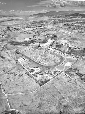This aerial view shows the historic footprint of the Lewis and Clark County Fairgrounds Racetrack circa 1970s.