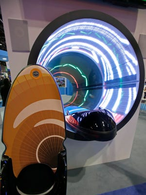 In this Tuesday, Nov. 18, 2014 photo, a mockup of the SlideBoarding water slide is seen at the International Association of Amusement Parks and Attractions convention and trade show in Orlando, Fla. (AP Photo/John Raoux)