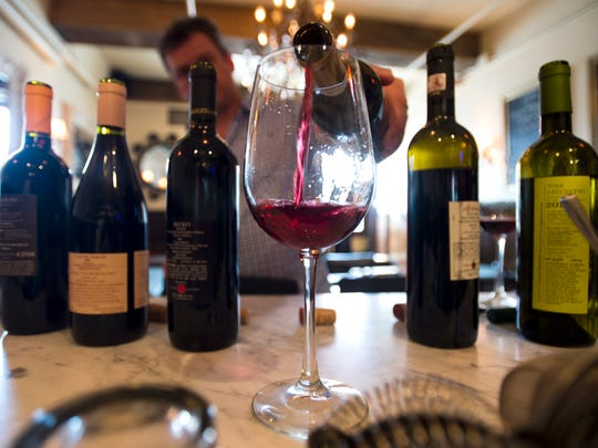 Italian wines are poured out at Sotto Enoteca, the wine bar started by Tom and Lori Delia next to their Trattoria Delia on St. Paul Street in Burlington, during a tasting to pick choice labels to serve.