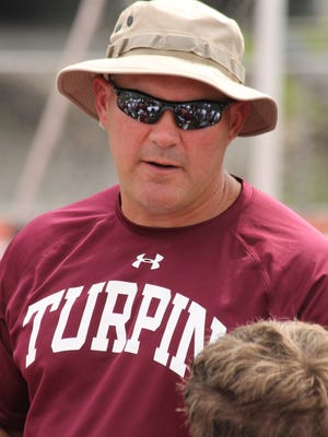 Turpin High School head football coach Rob Stoll guided the Spartans to his 100th win as their coach.
