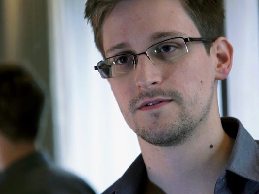 Spy vs. spy: Snowden presses Putin on surveillance