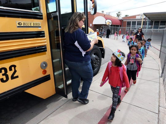 Students board buses at the end of the school day at