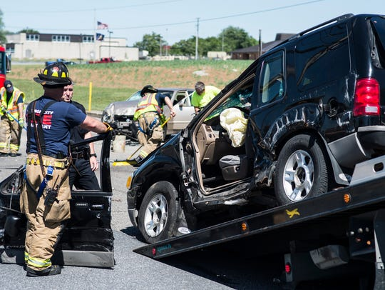 Crews clean up at the scene of a two-vehicle crash