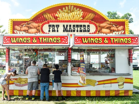Attendees at the Marion County Fair wait for their