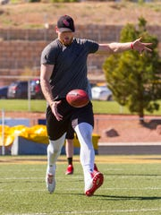 Tate Lewis punts for NFL scouts during SUU's Pro Day