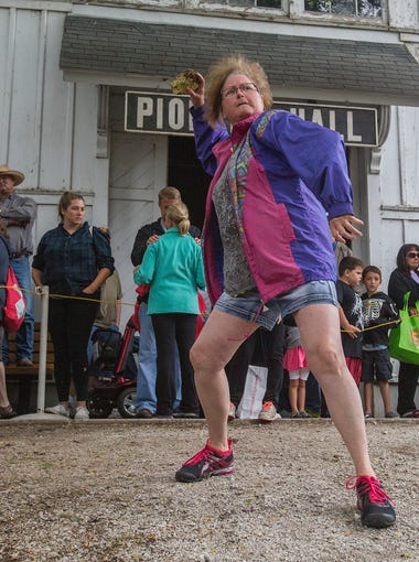 Becky Martin of Blakesburg throws at the KRNT Cow Chip Throwing Contest during the Iowa State Fair in Des Moines, Iowa, Wednesday, Aug. 19, 2015.