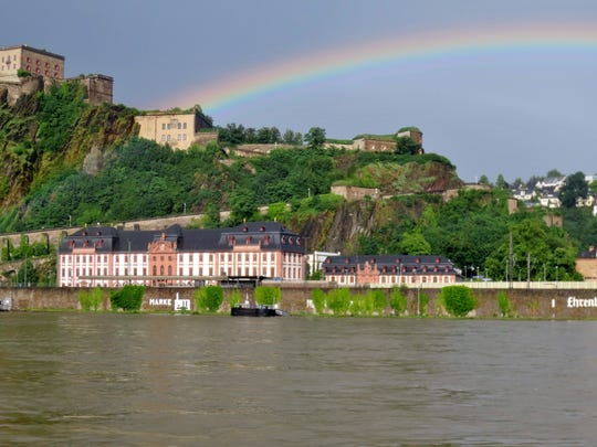 A rainbow arches over the Ehrenbreitstein Fortress following heavy rains in Koblenz, Germany.