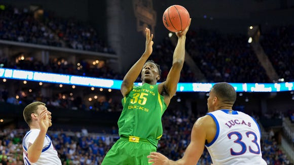 Mar 25, 2017; Kansas City, MO, USA; Oregon Ducks forward Kavell Bigby-Williams (35) shoots as Kansas Jayhawks forward Landen Lucas (33) guards during the first half in the finals of the Midwest Regional of the 2017 NCAA Tournament at Sprint Center. Mandatory Credit: Denny Medley-USA TODAY Sports