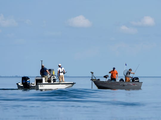 A transport boat picks up a newly caught fish during a fish hooking mortality study Tuesday, July 26, on Mille Lacs Lake.