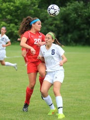 Going for the ball Friday night are Canton's Chloe