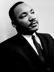 Dr. Martin Luther King Jr. is speaking before a press
