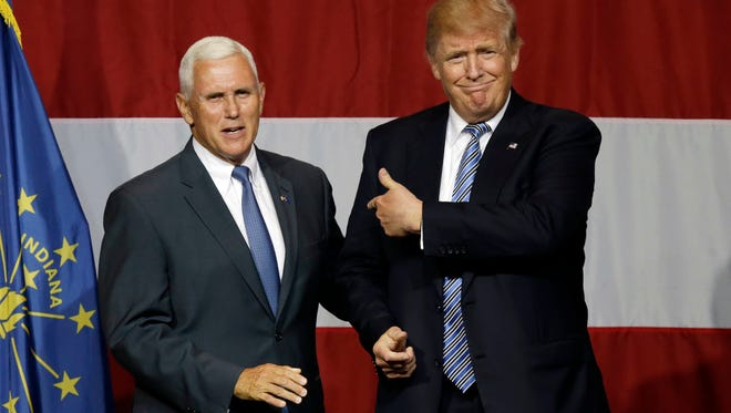 Indiana Gov. Mike Pence joins Republican presidential candidate Donald Trump at a rally in Westfield, Ind., on July 12, 2016.