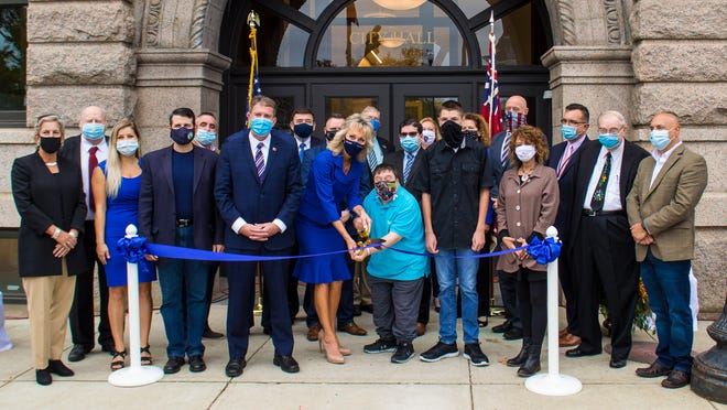 Mayor Shaunna O'Connell helped cut the ribbon on the reopening of Taunton City Hall that was held on Saturday, Oct. 24.