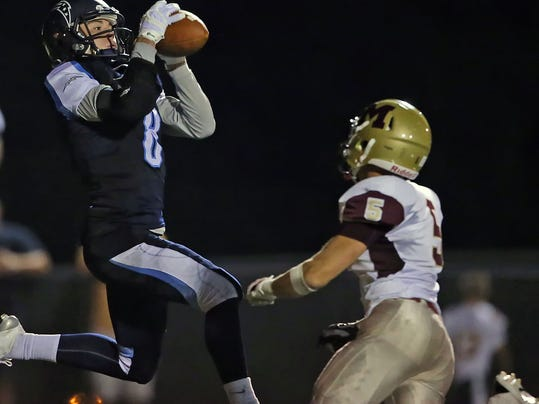 Manheim Twp.'s John Stutz (8) catches a touchdown pass in front of Governor Mifflin's A.J. Sczepkowski (5) during second half action at Manheim Twp. High School in Neffsville Friday September 18, 2015.