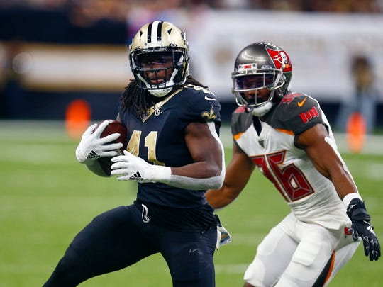 FILE - In this Oct. 6, 2019. file photo, New Orleans Saints running back Alvin Kamara (41) carries next to Tampa Bay Buccaneers cornerback M.J. Stewart (36) during the second half of an NFL football game in New Orleans. The versatile Kamara has been among New Orleans' most productive offensive players in both the running and passing games since 2017, when he was the NFL's offensive rookie of the year. In six games this season, he had 373 yards and one touchdown rushing along with 276 yards and one TD receiving. Kamara said he initially sought to come back from injury for New Orleans' Week 8 victory over Arizona, but changed his mind after visiting with team medical and training staff. (AP Photo/Butch Dill, File)