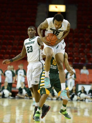 UW-Green Bay's Greg Mays (15) leaps into the air for a loose ball in the second half during Monday night's Horizon League game against Wright State at the Resch Center in Ashwaubenon. Evan Siegle/Press-Gazette Media