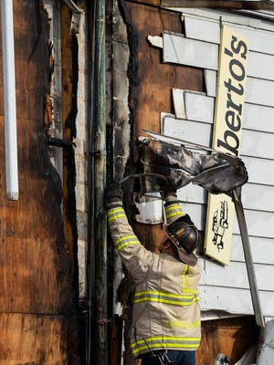Duane Trautman, Lebanon fire commissioner, investigates the scene after city fire crews were dispatched for an electrical fire at Roberto's Towing at 401 E. Cumberland St. at 10:41 a.m. on Wednesday, January 20, 2016. Fire police and Myerstown's Keystone Fire Co. assisted as well.