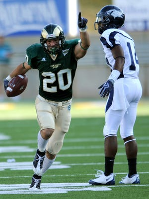In this Sept. 19, 2009, file photo, CSU defender Klint Kubiak celebrates after intercepting a pass during the game with Nevada in Fort Collins. Kubiak, the eldest son of Broncos head coach Gary Kubiak, has been hired as by Denver to be an offensive assistant who will work with the team's quarterbacks.