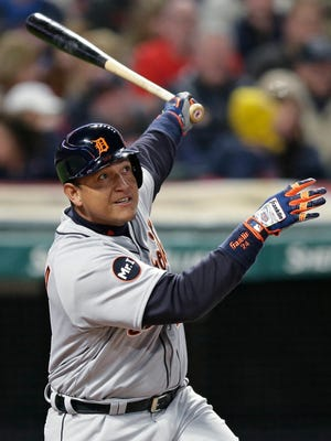 Tigers' Miguel Cabrera watches his three-run home run during the fifth inning.