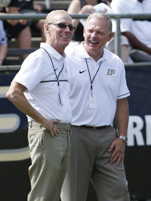 Morgan Burke, left, and Purdue athletic director Mike Bobinski, right, enjoy Purdue's football victory over Eastern Kentucky this past season.