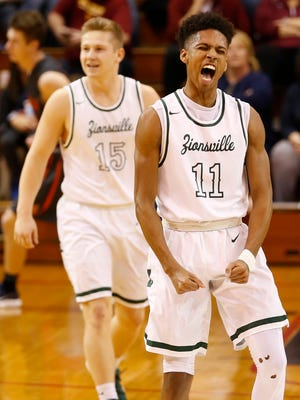 Zionsville's Isaiah Thompson lets out a scream after draining his sixth three-point shot in a row against Harrison in the sectional semifinal Friday, March 2, 2018, in Lafayette. Zionsville defeated Harrison 79-59. Thompson finished with 44 points.