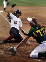Hillsborough #20 Olivia Warner safe at home as Montgomery's Peyton Schnackenberg covers the plate