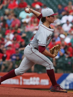 FSU's Tyler Holton (14) delivers a pitch against U of L at Slugger Field during the ACC Tournament. May 26, 2017