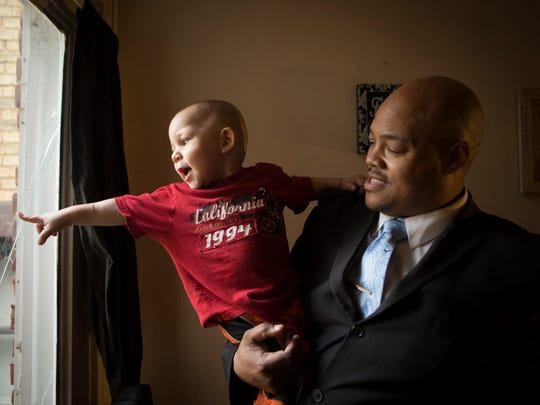 Reggie Hughes of Covington holds his son, Jayceon. Jayceon was born with neonatal abstinence syndrome, dependent on opioids because his mom had heroin addiction. He didn't have much withdrawal, Hughes said. But he did develop a head tilt. With treatment, Children's Hospital Medical Center found that this can be reversed.