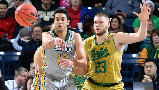 Southeastern Louisiana Lions guard Eddy Polanco (10) passes the ball as Notre Dame Fighting Irish forward Martinas Geben (23) defends in the first half at the Purcell Pavilion.