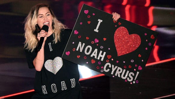 Sister of the year, Miley Cyrus.