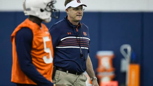 Auburn head coach Gus Malzahn evaluating the quarterback