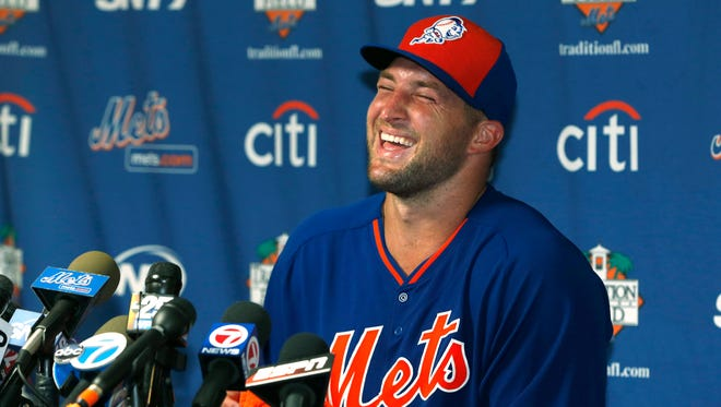 Tim Tebow laughs as he answers questions during a news conference at the New York Mets' complex, Monday, Sept. 19, 2016, in Port St. Lucie, Fla. The 2007 Heisman Trophy winner and former NFL quarterback got to the complex early Monday, and started his first workout as part of their instructional league team.
