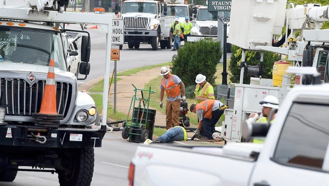Utility trucks fill the road and crews work to replace several utility poles following an early morning wreck on Greenville Avenue. The road remains closed between Gay Street and Richmond Road as they work Wednesday, July 26, 2017.