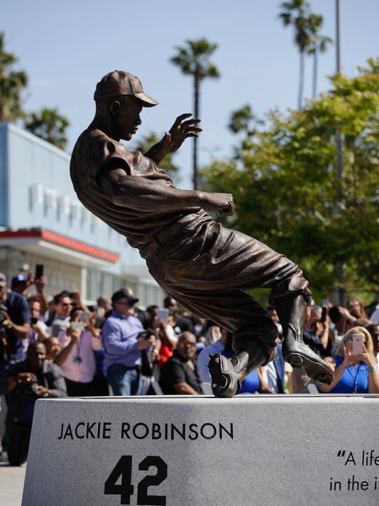 A bronze statue of Brooklyn Dodgers' Jackie Robinson is unveiled outside Dodger Stadium in Los Angeles before the Los Angeles Dodgers' baseball game against the Arizona Diamondbacks, Saturday, April 15, 2017, in Los Angeles. (AP Photo/Jae C. Hong)