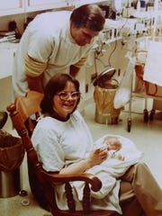 A picture of Cecelia and David Flory taken on March 15, 1980, holding their very tiny daughter Kasey Tuffy (Flory) Hadd who was born as a preemie on Christmas Eve 1979 weighing in at 15 oz at Sparrow Hospital in Lansing, Michigan.  Flory family photo handout