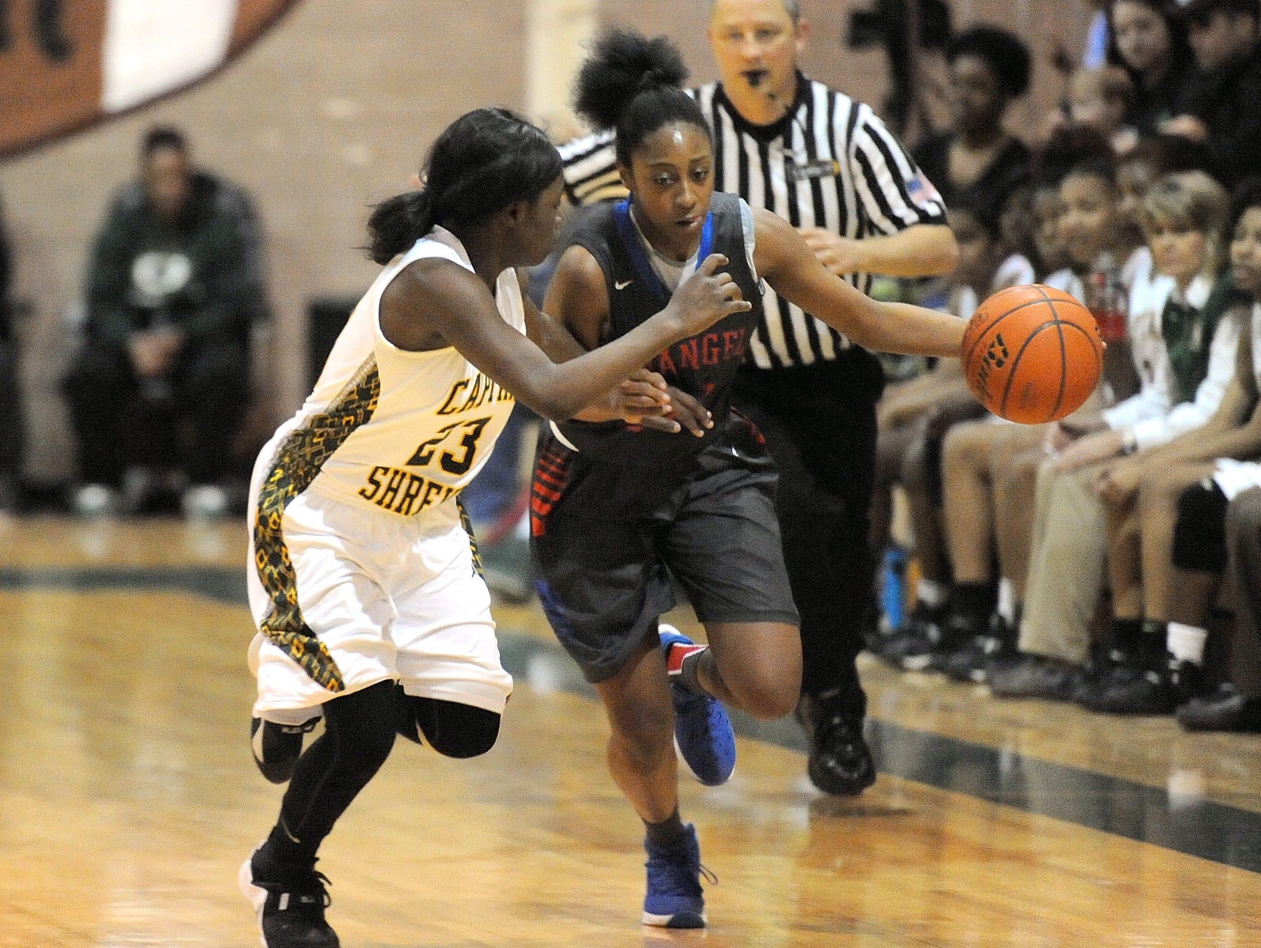 Evangel's Tiara Young drives to the basket last season.